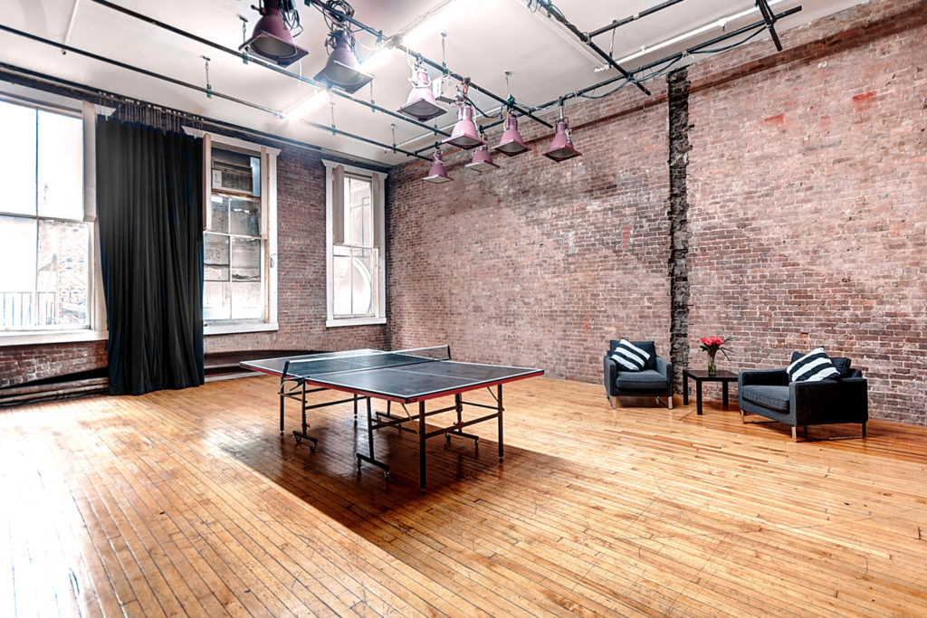 photo and film studio with exposed brick